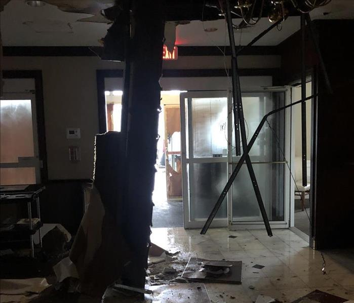 Water damage has caused a ceiling to collapse in the hallway of a hotel.