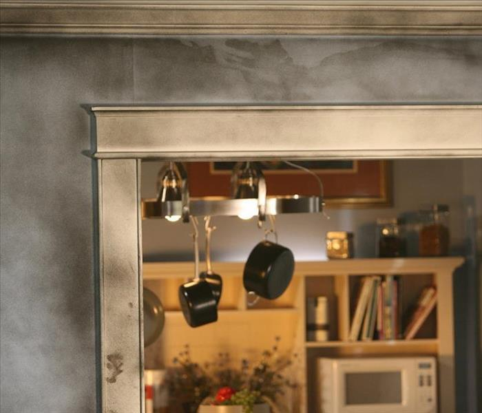 Fire damage to a home has left soot all over the walls and cabinetry.